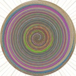 A circle of color spirals inward changing as it moves